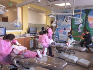 "more than 60 children received free dental exams, cleaning and fluoride treatment at the Rohnert Park Health Center's ""Give Kids a Smile' event."